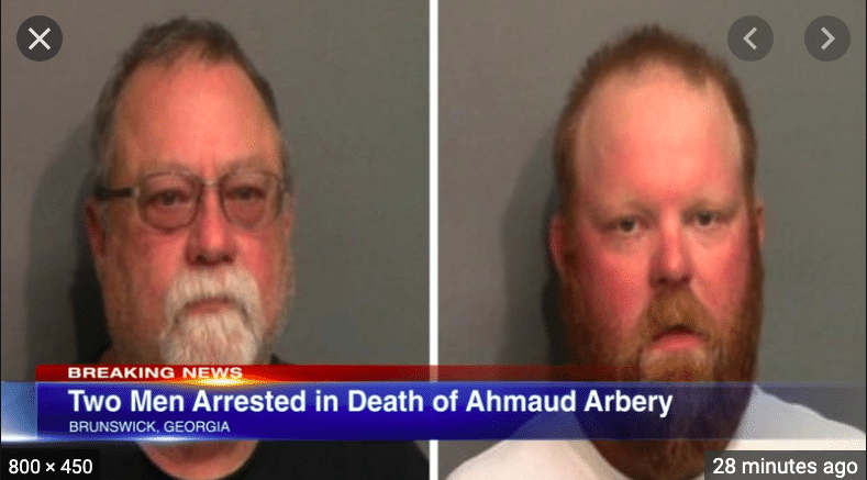 A white father and son accused of fatally shooting a black man on a residential Georgia street were arrested Thursday.